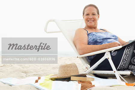 Portrait of Woman on the Beach Stock Photo - Premium Royalty-Free, Image code: 600-01606836