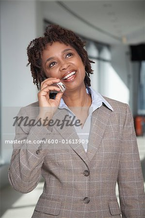 Businessman Talking on Cell Phone Stock Photo - Premium Royalty-Free, Image code: 600-01613909