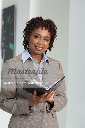 Businesswoman with Agenda Stock Photo - Premium Royalty-Free, Image code: 600-01613915