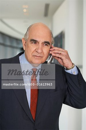 Businessman with Cellular Phone Stock Photo - Premium Royalty-Free, Image code: 600-01613963