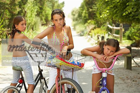 Girls Riding Bicycles Stock Photo - Premium Royalty-Free, Image code: 600-01614174