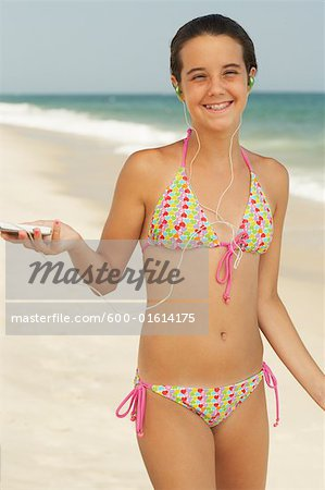 Girl on Beach With Mp3 Player Stock Photo - Premium Royalty-Free, Image code: 600-01614175