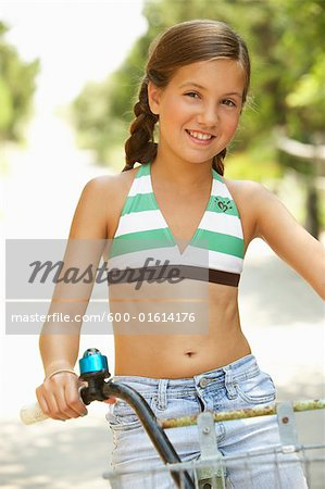 Girl Riding Bicycle Stock Photo - Premium Royalty-Free, Image code: 600-01614176