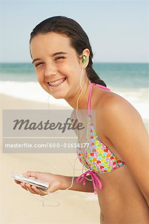 Girl on Beach With Mp3 Player Stock Photo - Premium Royalty-Free, Image code: 600-01614177
