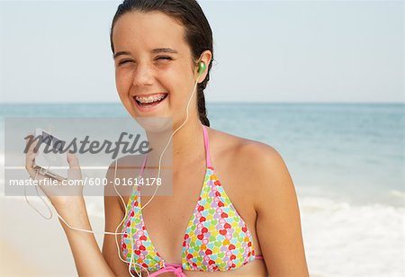 Girl on Beach With Mp3 Player Stock Photo - Premium Royalty-Free, Image code: 600-01614178