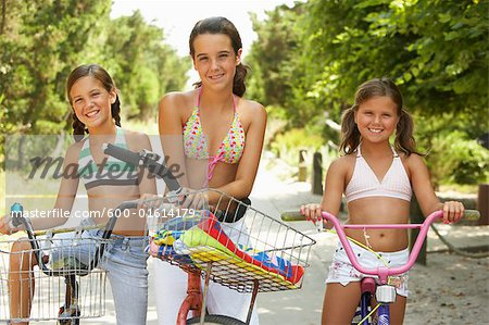 Girls Riding Bicycles Stock Photo - Premium Royalty-Free, Image code: 600-01614179