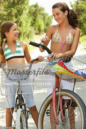 Girls Riding Bicycles Stock Photo - Premium Royalty-Free, Image code: 600-01614181