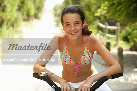 Girl Riding Bicycle Stock Photo - Premium Royalty-Free, Image code: 600-01614182