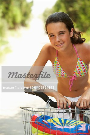 Girl Riding Bicycle Stock Photo - Premium Royalty-Free, Image code: 600-01614183
