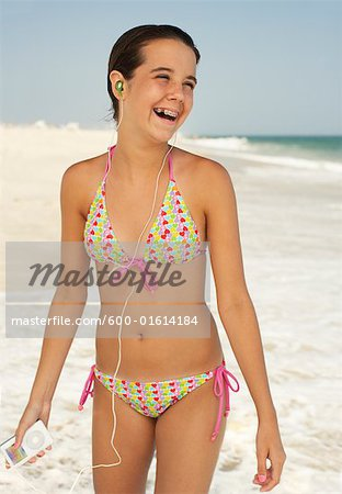 Girl on Beach With Mp3 Player Stock Photo - Premium Royalty-Free, Image code: 600-01614184