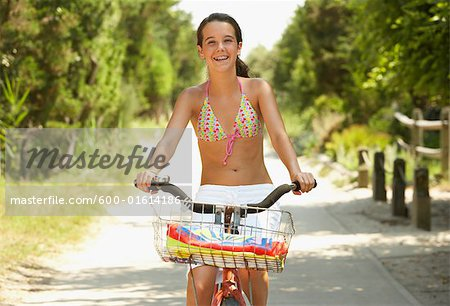Girl Riding Bicycle Stock Photo - Premium Royalty-Free, Image code: 600-01614186