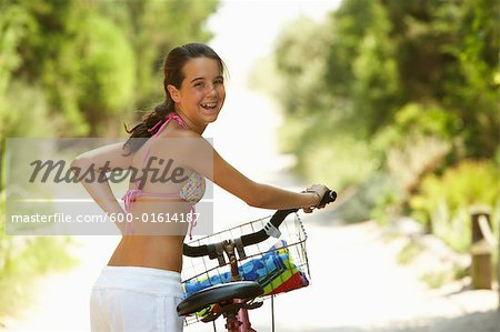 Girl Riding Bicycle Stock Photo - Premium Royalty-Free, Image code: 600-01614187