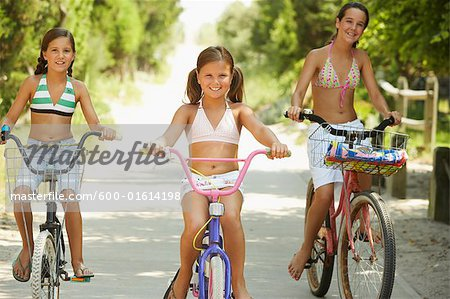 Girls Riding Bicycles Stock Photo - Premium Royalty-Free, Image code: 600-01614198