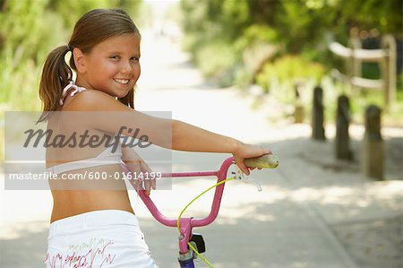 Girl Riding Bicycle Stock Photo - Premium Royalty-Free, Image code: 600-01614199