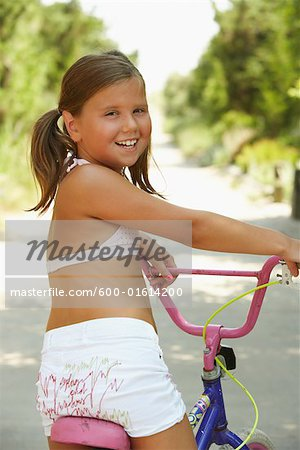Girl Riding Bicycle Stock Photo - Premium Royalty-Free, Image code: 600-01614200