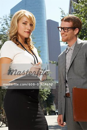 Businessman and Businesswoman Stock Photo - Premium Royalty-Free, Image code: 600-01614692