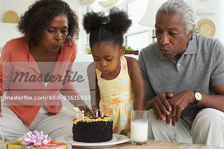 Family celebrating birthday Stock Photo - Premium Royalty-Free, Image code: 600-01615053