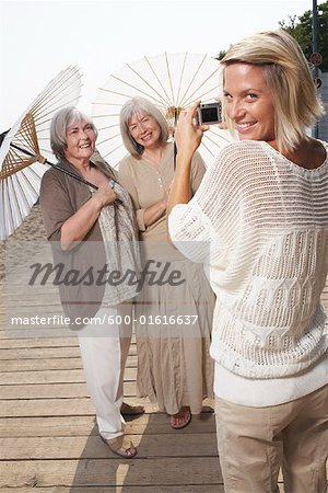 Women Posing for Picture on Boardwalk Stock Photo - Premium Royalty-Free, Image code: 600-01616637
