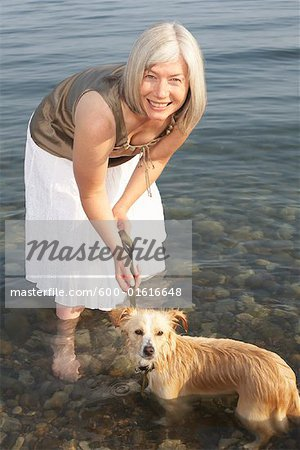 Woman With Dog in Water Stock Photo - Premium Royalty-Free, Image code: 600-01616648