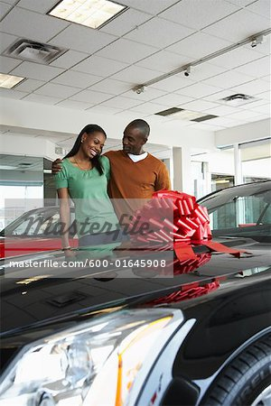 Couple With New Car Stock Photo - Premium Royalty-Free, Image code: 600-01645908