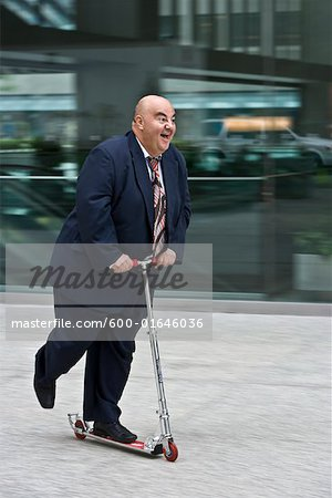 Businessman on Scooter Stock Photo - Premium Royalty-Free, Image code: 600-01646036