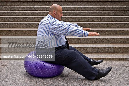 Businessman Using Exercise Ball Stock Photo - Premium Royalty-Free, Image code: 600-01646039