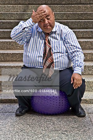 Businessman Using Exercise Ball Stock Photo - Premium Royalty-Free, Image code: 600-01646041