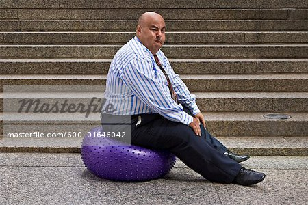 Businessman Using Exercise Ball Stock Photo - Premium Royalty-Free, Image code: 600-01646042