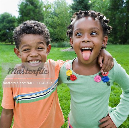 Siblings Goofing Around Stock Photo - Premium Royalty-Free, Image code: 600-01646323
