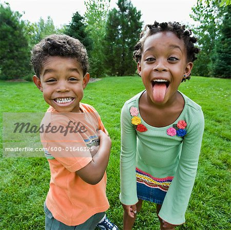 Siblings Goofing Around Stock Photo - Premium Royalty-Free, Image code: 600-01646325