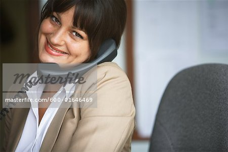 Businesswoman Talking on Phone Stock Photo - Premium Royalty-Free, Image code: 600-01646469