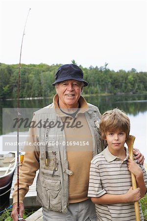 Man and Boy by Lake with Fishing Gear