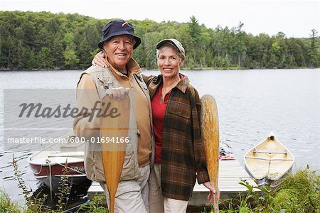 Couple by Dock with Canoe Paddles Stock Photo - Premium Royalty-Free, Image code: 600-01694166
