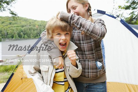 Brother and Sister Camping Stock Photo - Premium Royalty-Free, Image code: 600-01694172