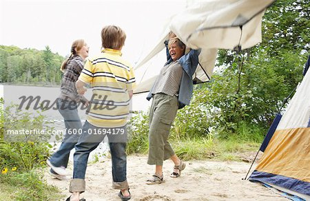 Mother and Children on Campsite Stock Photo - Premium Royalty-Free, Image code: 600-01694179