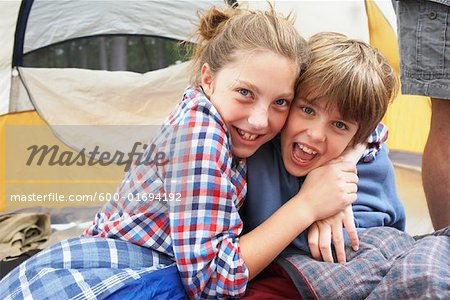 Brother and Sister in Tent Stock Photo - Premium Royalty-Free, Image code: 600-01694192