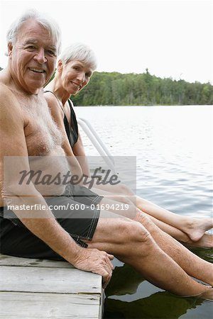 Couple Sitting on Dock Stock Photo - Premium Royalty-Free, Image code: 600-01694219