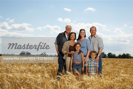 Portrait of Family in Grain Field Stock Photo - Premium Royalty-Free, Image code: 600-01716057