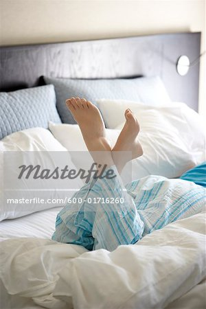 Woman Lying on Bed Stock Photo - Premium Royalty-Free, Image code: 600-01716260