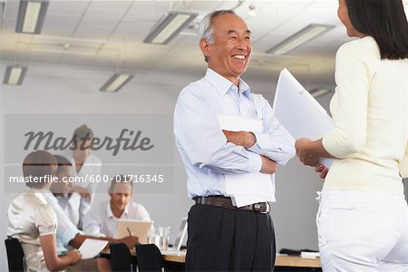 Business Meeting Stock Photo - Premium Royalty-Free, Image code: 600-01716345