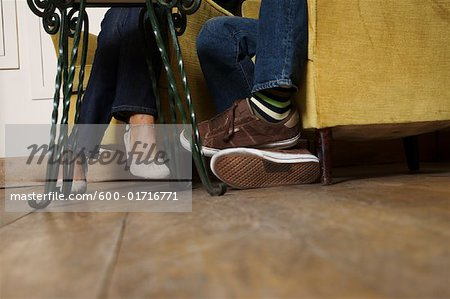 Feet of Couple Sitting Stock Photo - Premium Royalty-Free, Image code: 600-01716771