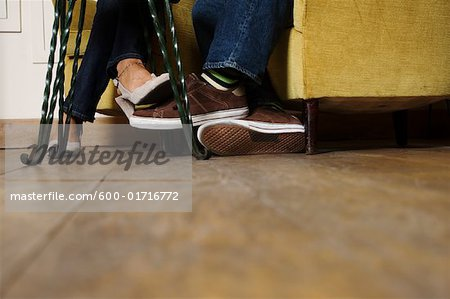 Couple Playing Footsie Stock Photo - Premium Royalty-Free, Image code: 600-01716772