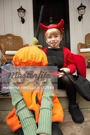 Portrait of Girl Dressed-up as Pumpkin and Boy Dressed-up as Devil Stock Photo - Premium Royalty-Free, Image code: 600-01717680