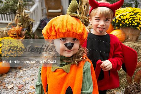 Portrait of Girl Dressed-up as Pumpkin and Boy Dressed-up as Devil Stock Photo - Premium Royalty-Free, Image code: 600-01717683
