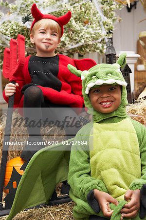 Portrait of Boy Dressed-up as Dragon with Boy Dressed-up as Devil Stock Photo - Premium Royalty-Free, Image code: 600-01717684