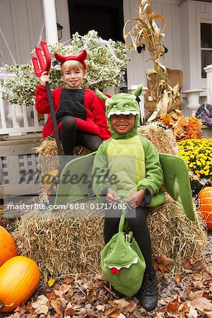 Portrait of Boy Dressed-up as Dragon with Boy Dressed-up as Devil Stock Photo - Premium Royalty-Free, Image code: 600-01717685