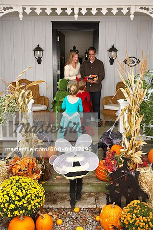 Children Trick or Treating at Halloween Stock Photo - Premium Royalty-Free, Image code: 600-01717690