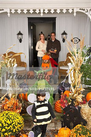 Children Trick or Treating at Halloween Stock Photo - Premium Royalty-Free, Image code: 600-01717691