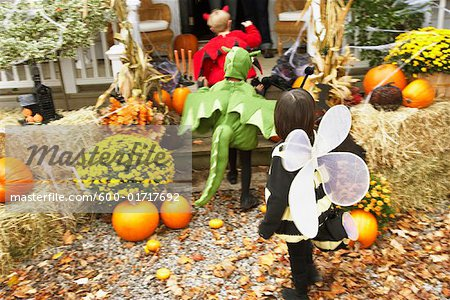 Children Trick or Treating at Halloween Stock Photo - Premium Royalty-Free, Image code: 600-01717692