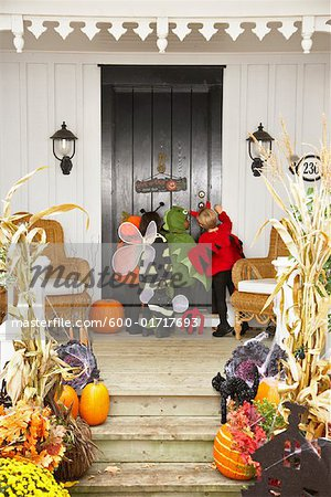 Children Trick or Treating at Halloween Stock Photo - Premium Royalty-Free, Image code: 600-01717693